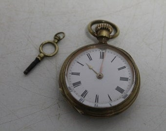 Swiss pocket watch with key