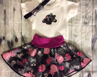 Baby sugar skull outfit.  Came and pink skulls. Circle skirt and onesie bodysuit. Free bow.  Free shipping.  Baby shower gift set.