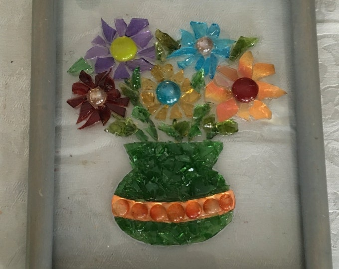 Floral bouquet on glass picture frame