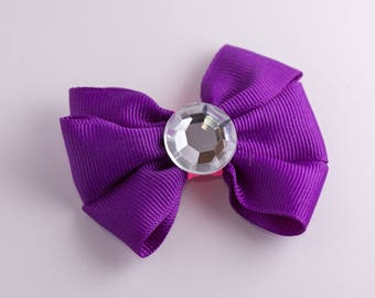 Purple and pink hair bow with gem center