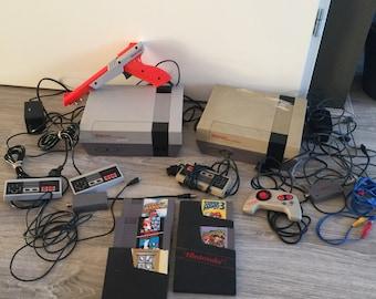 Nintendo (NES) 2x, controllers 4x, zapper, games 6x