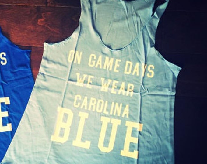 On Gamedays We Wear Carolina Blue