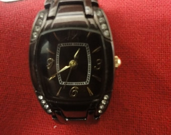 Ladies fashion watch in brown and gold