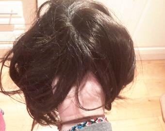 Dark brown / black wig