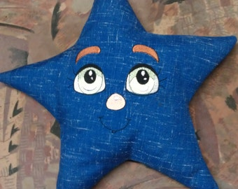 Star cushion with embroidered face