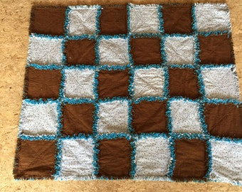 Hand made brown and blue rag quilt