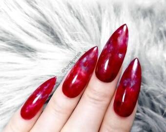Fetish fingernail nipple red