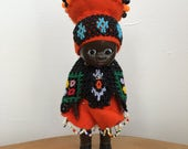 Vintage Hard Plastic African Doll  orange felt black and multicoloured woven beadwork costume