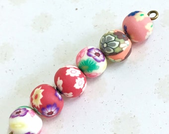 20 round polymer clay beads, 8mm bead mix, multiple colours and patterns.  Random mix Fimo beads. Floral pattern beads.