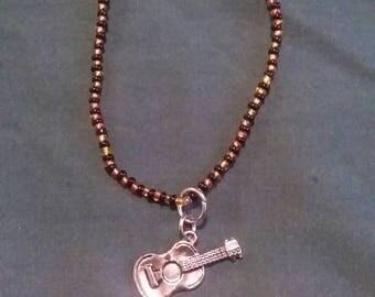 Night in the Woods Gregg Guitar Charm Beaded Bracelet