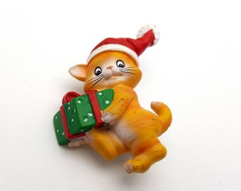 Resin Orange Tabby Cat with Hat Carrying Christmas Gift Vintage 90s Brooch Pin Kitten Holiday Kitty Brooch December