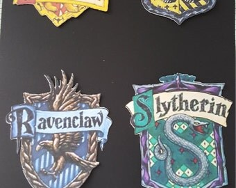 Harry Potter House Crests (x8) one of each in colour and one of each in black and white. Gryffindor, Ravenclaw, Slytherin, Hufflepuff
