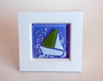 Fused glass green and white yacht/boat in a white wooden frame.
