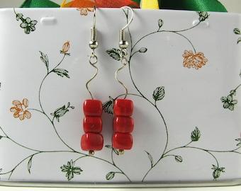 Three red cube earrings