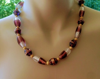 Necklace with purple lamp work beads
