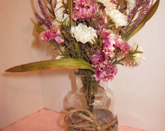 Pretty Arrangment In A Clear Glass Apothecary Bottle