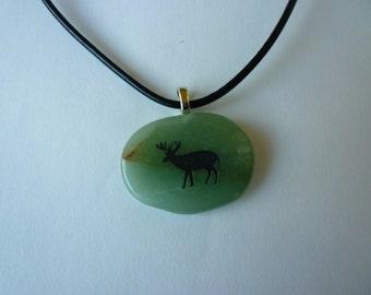 Deer pendant on aventurine stone.