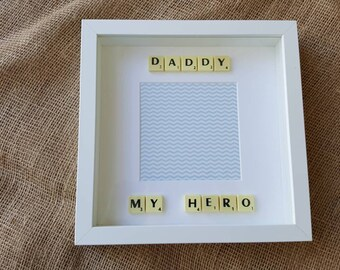 Stunning fathers day photo frame with the beautiful wording Daddy my hero