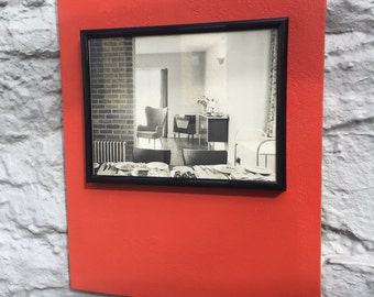 A vintage interior design photo mounted on an orange canvas