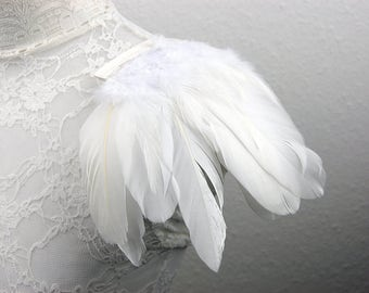 white feather epaulettes