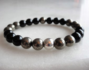 Onyx and pyrite bracelet with sterling silver bead