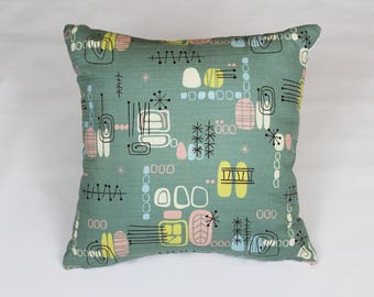 Decorative pillow crafted from vintage inspired barkcloth and new designer fabric.