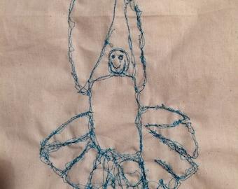 Kids' drawings sewn onto a bag