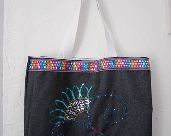 Embroidered beach bag has hand
