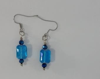 Custom hand made earrings clear blue glass bead