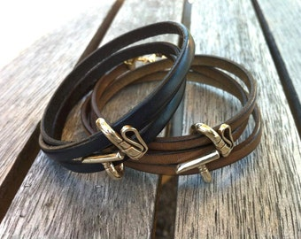 Silver polo mallet on leather bracelet