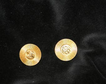 Chanel sunburst cuff links