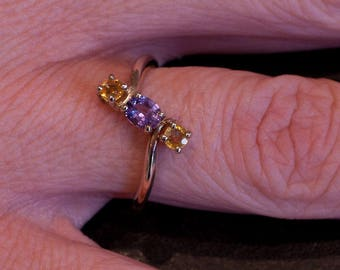 Natural certified yellow and purple Sapphire Trilogy 9k yellow gold ring