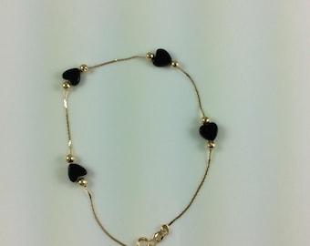 Vintage 14k gold black heart bracelet
