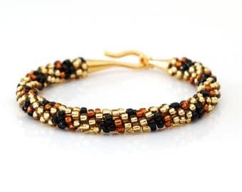 Cheetah print beaded kumihimo bracelet