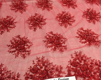 Red gaviota design embroider and beaded on a mesh lace. Wedding/Bridal/Prom/Nightgown fabric. Sold by the yard.