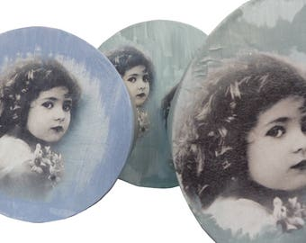 Round boxes with the image of girls