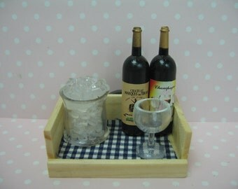 Miniature dolls house wine glass ice on a tray