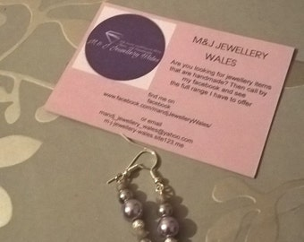 Purple, light purple and silver spacers on silver plated