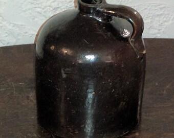 Brown Stoneware whiskey jug