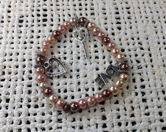 Brown and tan pearl bead love charm bracelet