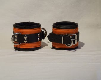 Leather wrist cuffs, genuine leather, soft padded, orange-and black