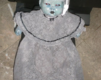 Living dead zombie baby doll.