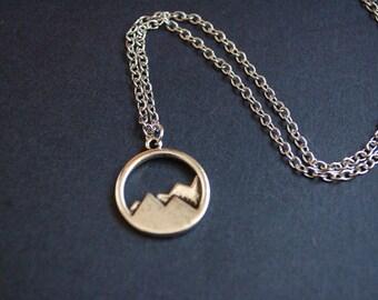 Antique silver tone mountain scene necklace