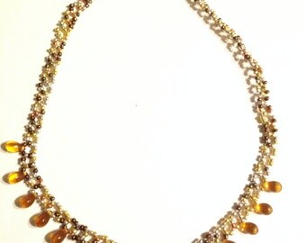 Gold colored beaded necklace