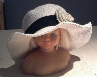 Hat Cloche crochet hat with a brim and flower. Beige with black stripes.