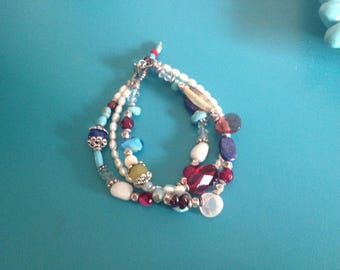 Triple strand bracelet with semi precious stones