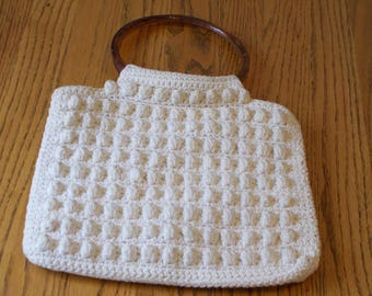 cream knitted purse with plastic handles