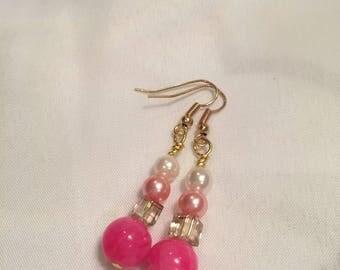 Pink tone dangle earrings