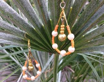 Pair of earrings dangle (orange) oval creole type