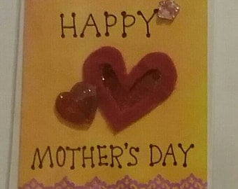 Bespoke handmade MOTHERS DAY card. Blank inside to write your own message. Hand painted in orange tones with red heart embellishment A6 size